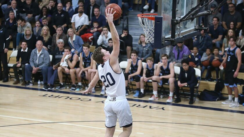 Newport Harbor High's Sam Barela slams it home after a steal during a Surf League game against Corona del Mar on Friday.