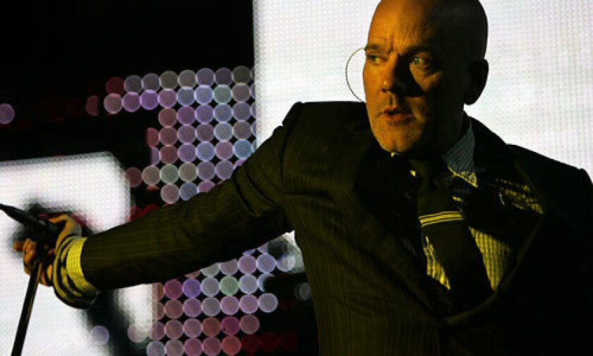 Singer Michael Stipe leads veteran alternative rock band R.E.M. through a concert at the Hollywood Bowl.
