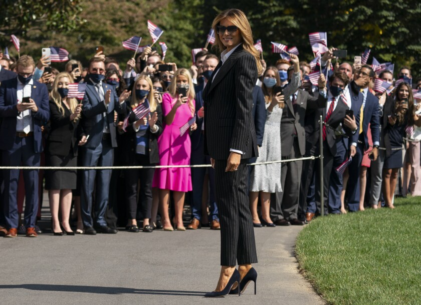 First lady Melania Trump pauses as she and President Donald Trump walk to board Marine One at the White House, Tuesday, Sept. 29, 2020, in Washington, for the short trip to Andrews Air Force Base en route to Cleveland for first debate against Democrat Joe Biden. (AP Photo/Carolyn Kaster)