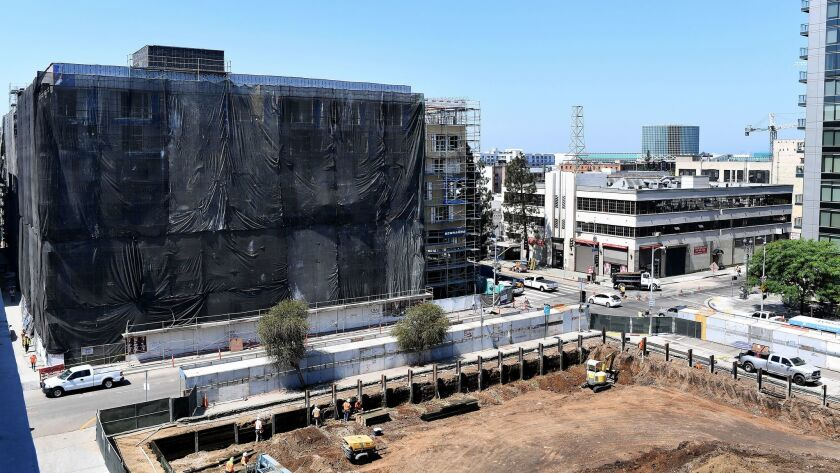 A building at the corner of 12th and Grand is under construction in downtown Los Angeles on August 3.