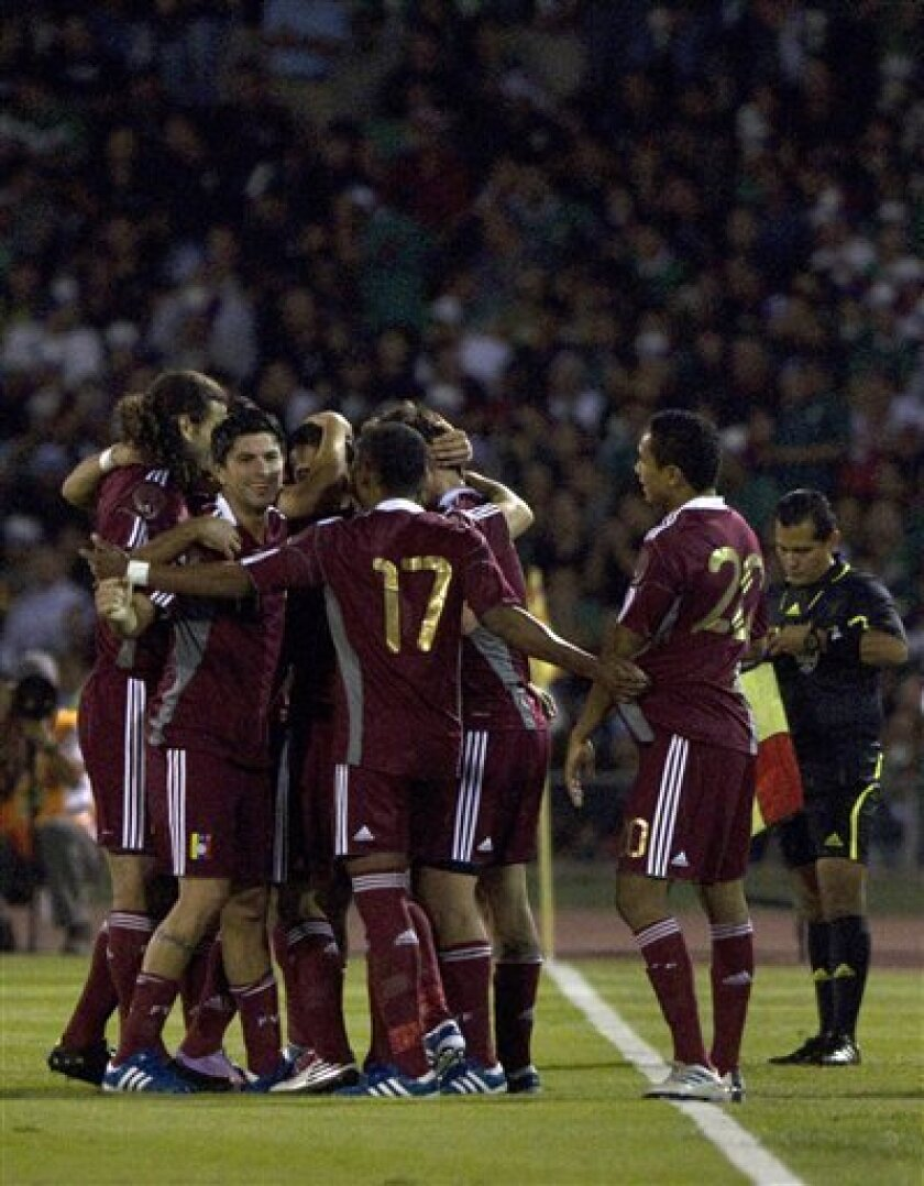 Venezuela's players celebrate after scoring against Mexico during a friendly soccer match at the Benito Juarez stadium in Ciudad Juarez, Mexico, Tuesday, Oct. 12, 2010. (AP Photo/Guillermo Arias)