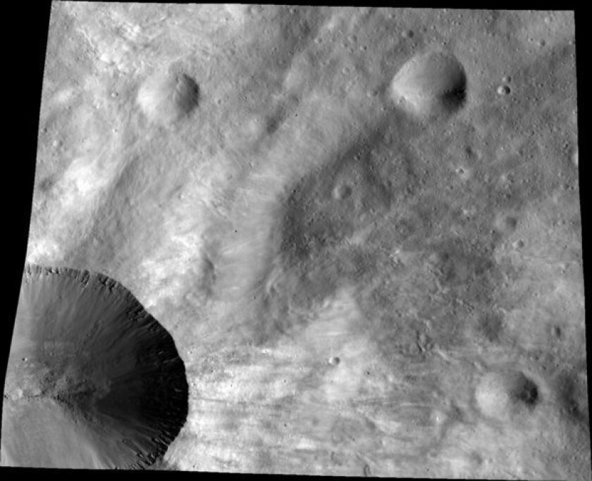 Proto-planet Vesta's weathering is unlike other airless bodies
