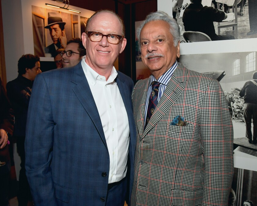 Capitol Music Group Chairman and CEO Steve Barnett, left, and I.M.I. Incorporated Chairman and CEO Bhaskar Menon