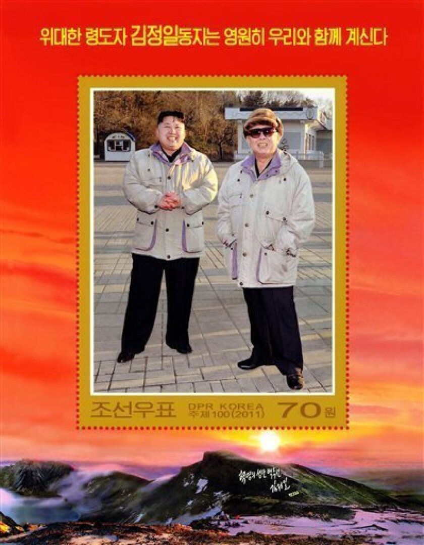 This undated photo copy released by the Korean Central News Agency and distributed in Tokyo by the Korea News Service on Friday, Dec. 30, 2011 shows a commemorative postage stamp featuring Kim Jong Un, left, and his late father Kim Jong Il. Kim Jong Un made his debut on the postage stamp: a 70-won