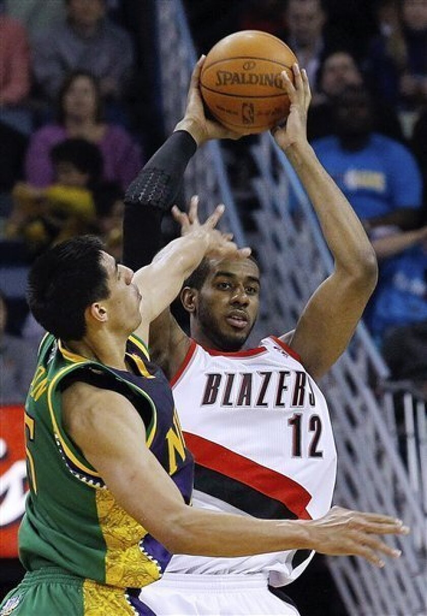 Portland Trail Blazers forward LaMarcus Aldridge (12) looks for room around New Orleans Hornets forward Gustavo Ayon during the first half of an NBA basketball game in New Orleans, Friday, Feb. 10, 2012. (AP Photo/Bill Haber)