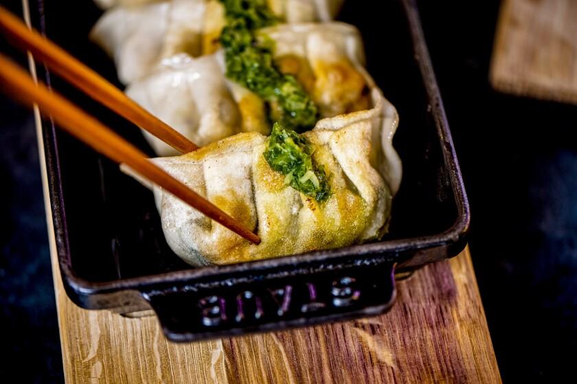 Sa'Moto dumplings in a mini iron baking dish.
