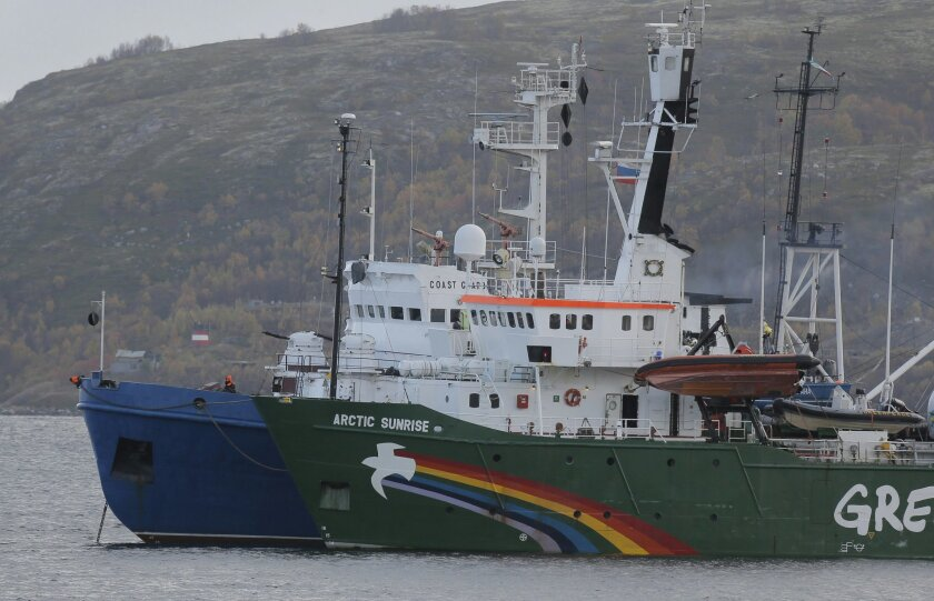FILE - This is a Tuesday, Sept. 24, 2013. file photo of Greenpeace ship 'Arctic Sunrise' as it is escorted by a Russian coast guard boat, in Kola Bay at the military base Severomorsk on the Kola peninsula in Russia. Greenpeace International says Russian authorities have informed the activist group they will release the ship Arctic Sunrise, which has been held in Murmansk since it was seized during a protest against an offshore oil platform in September 2013. Amsterdam-based Greenpeace said Friday June 6, 2014 it still believes the actions of Russian authorities in seizing the ship and arresting 30 people on board were against international law. (AP Photo/Efrem Lukatsky, File)