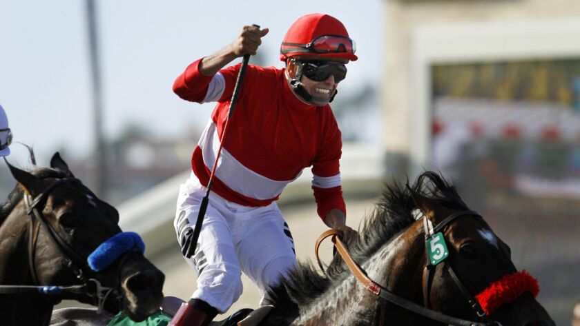 Patrick Valenzuela celebrates after winning the 21st running of the Pacific Classic aboard Acclamation at the Del Mar Thoroughbred Club on Sunday, August 28, 2011.