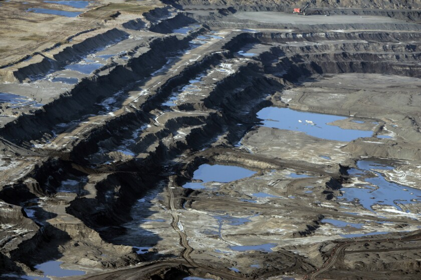 A tar sands mine in Alberta, Canada. President Obama has vetoed legislation that would have ordered approval for the Keystone pipeline, designed to carry oil to Gulf Coast refineries.