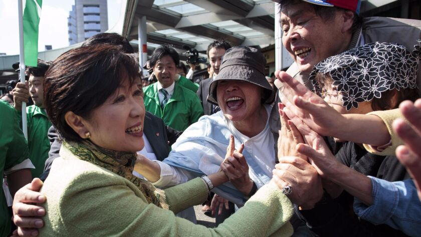 Tokyo Gov. Yuriko Koike greets her supporters during an election campaign appearance in Saitama on Oct. 18.