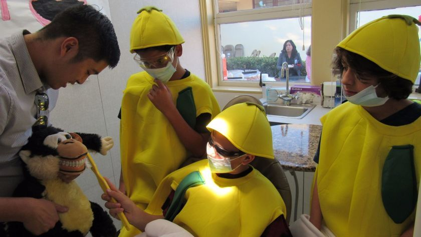 In 2017, then-Lemon Grove Academy eighth graders (left to right) Efrain Duarte, Emillio Cecena and Sam Oser got a lesson in dental health from Clinic Manager Jonathan Wong. UCSD School of Medicine's doctors and volunteers treat students and their families at no cost at the on-campus clinic.