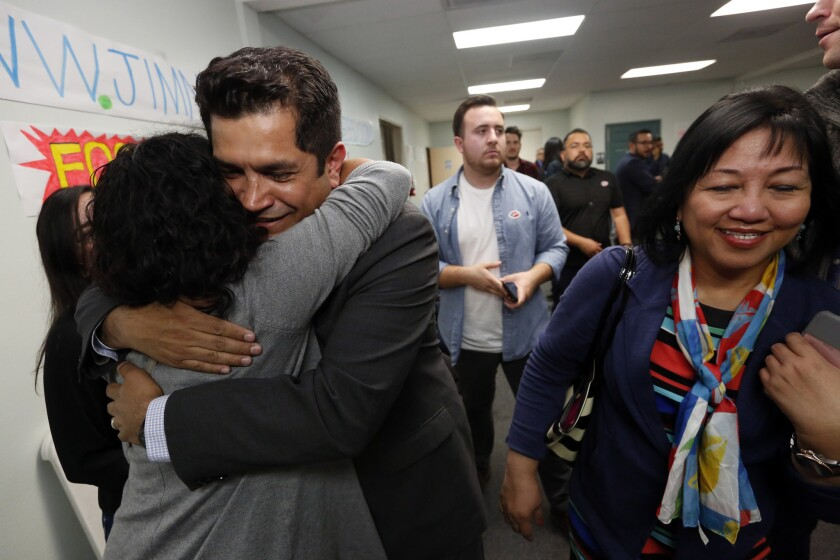 Assemblyman Jimmy Gomez, a candidate for the 34th Congressional District seat, hugs a supporter during the April 4 primary election night.