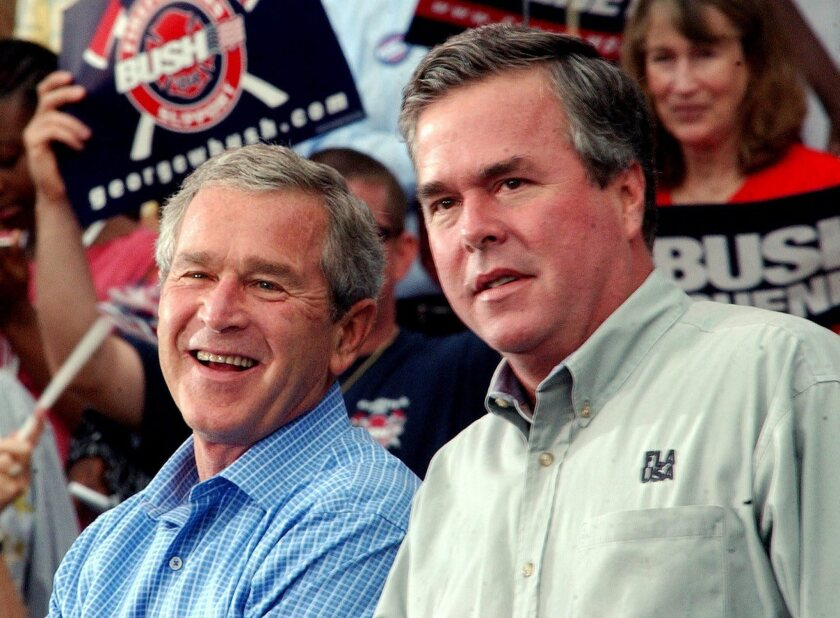 President George W. Bush with his brother. then-Florida Gov. Jeb Bush, at a campaign rally in October 2004.