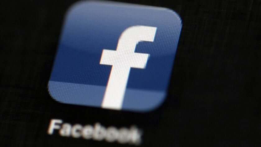 FILE - In this May 16, 2012, file photo, the Facebook logo is displayed on a mobile device in Philad