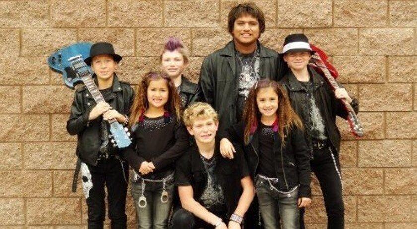 The Santana Brothers Band includes, back row, Julian Leon, Nathan Santana, Daniel Santana, Brendan Santana; and, front row, Melissa Leon, Alexander Santana and Catrina Leon.