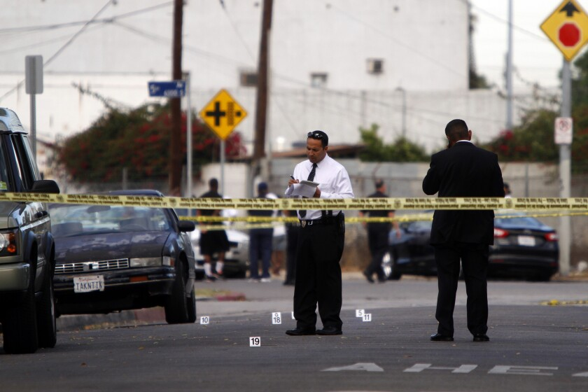 Police tape marks the area where two people were killed Tuesday in a shooting in South Los Angeles.