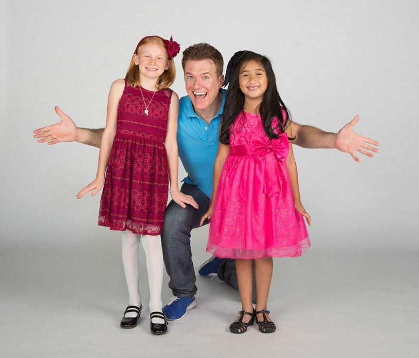 Reese McCulloch and Abigail Estrella appear as Cindy-Lou Who with Edward Watts as The Grinch (center