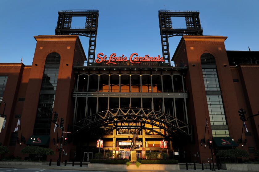 Busch Stadium, home of the St. Louis Cardinals, remains quiet Friday, Aug. 7, 2020, in St. Louis. Major League Baseball announced Friday night that the entire three-game series between the Chicago Cubs and Cardinals set for this weekend in St. Louis has been postponed after two more Cardinals players and a staff member tested positive for the coronavirus. (AP Photo/Jeff Roberson)