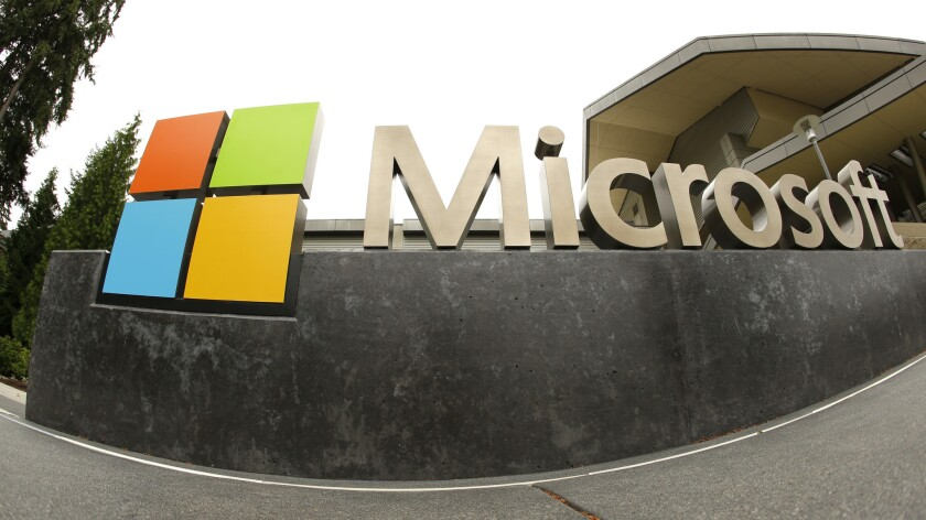 FILE - This July 3, 2014, file photo, shows the Microsoft Corp. logo outside the Microsoft Visitor C