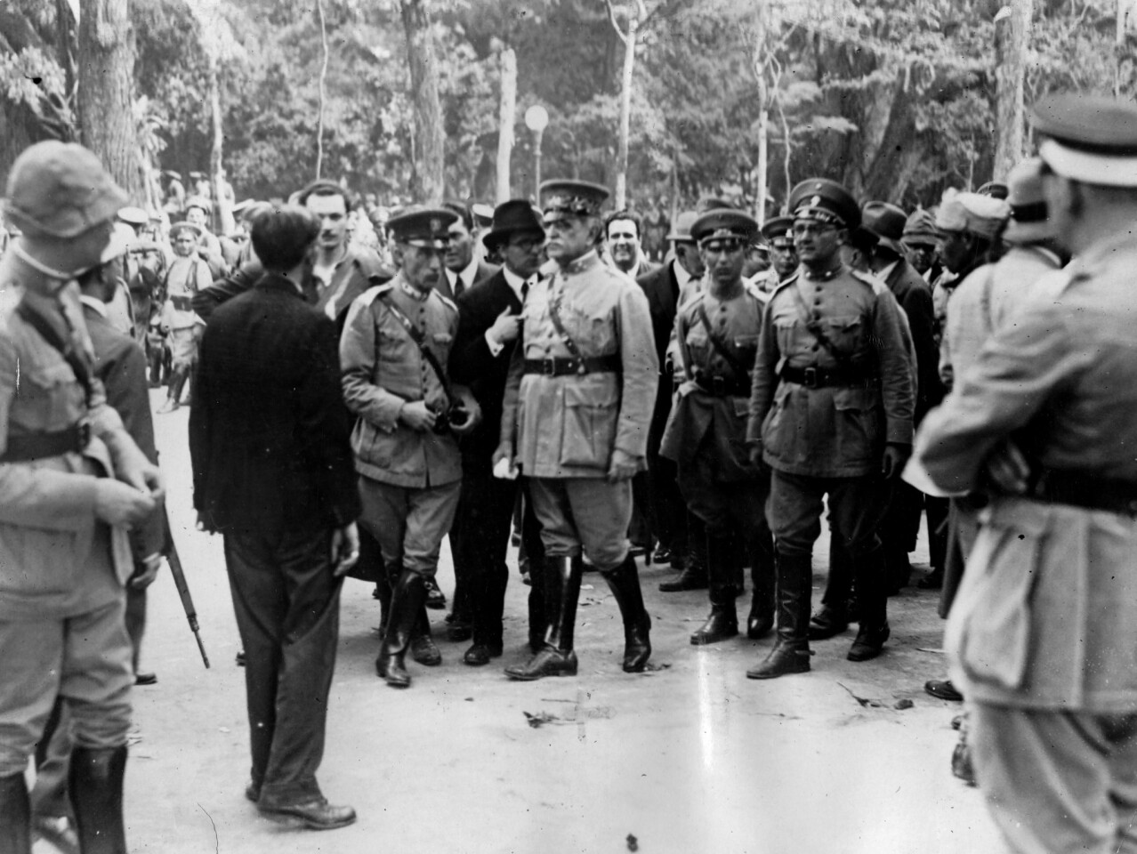 In this image from 1930, Gen. Tasso Fragoso, president of Brazil's provisional junta, reviews troops in front of the palace of the deposed president.