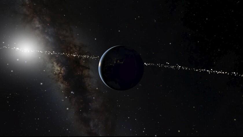 Esta ilustración proveída por el Museo de Historia Natural en Nueva York muestra el planeta Tierra, al centro