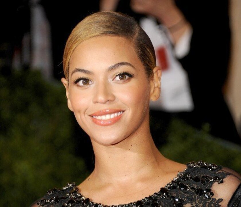 Beyonce Knowles, seen here at the Metropolitan Museum of Art Costume Institute gala will be on the cover of GQ as o ne of 100 sexiest women of the century.