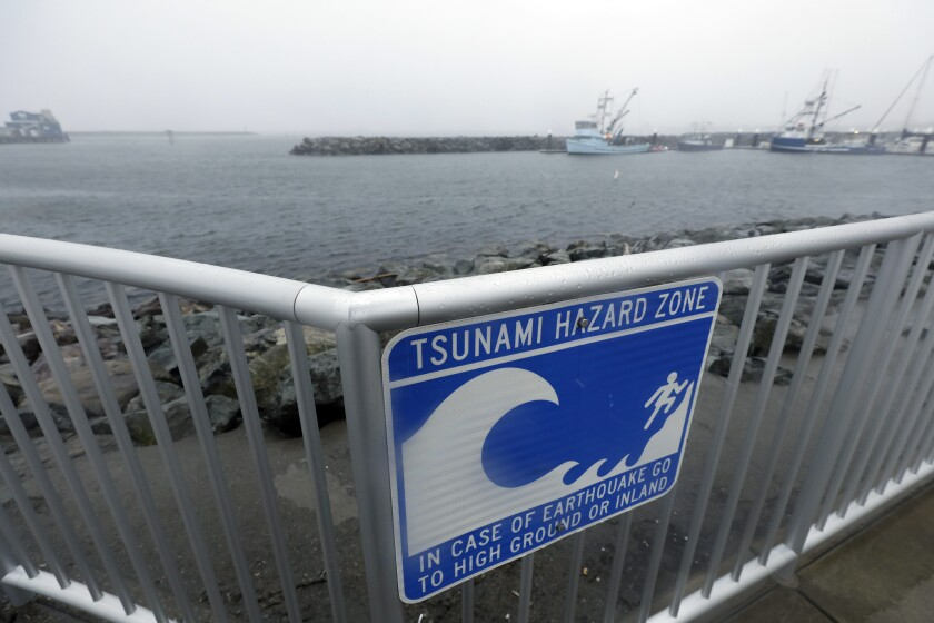 A sign warns of a tsunami hazard zone at the coast in Crescent City