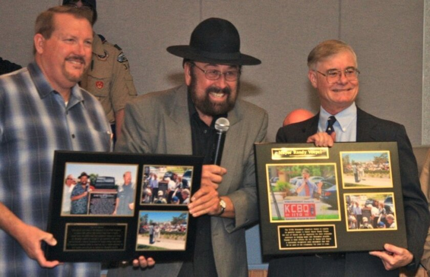 "At a recent Santee City Council meeting, Santee Vice Mayor John Minto (left), ""Shotgun Tom"" Kelly and Santee Mayor Randy Voepel relive some moments preserved on plaques that highlight last August's"