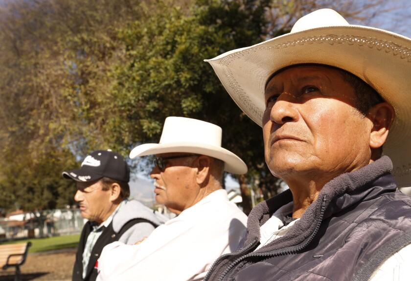 Jesus Rodriguez, right, joins friends in Veterans Memorial Park in Santa Paula on Feb. 14.