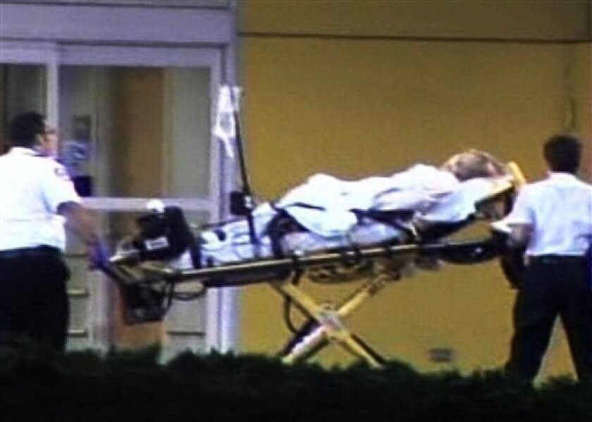 This image taken from video provided by AP Television News shows an unidentified woman being brought into Health Central hospital in Ocoee, Fla. Tuesday, Dec. 8, 2009. Fire department medics responded early Tuesday to a 911 call in the same block as Tiger Woods' Orlando-area home and took an adult patient to the hospital. (AP Photo/AP Television News)