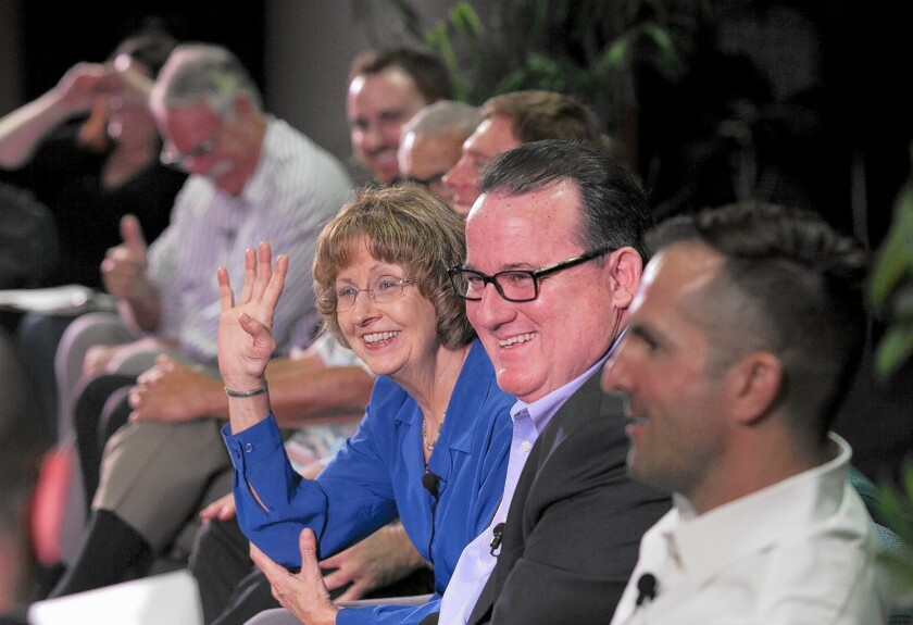 Rita Simpson, left, Mayor Jim Righeimer and Christopher Bunyan and the other city council candidates laugh during a light moment at the Feet to the Fire forum on Thursday at Orange Coast College.