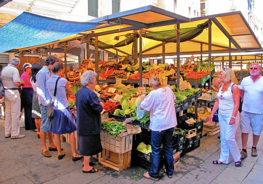 European farmers markets, like this one in Venice, Italy, attract shoppers who think daily about the ingredients for fresh meals.
