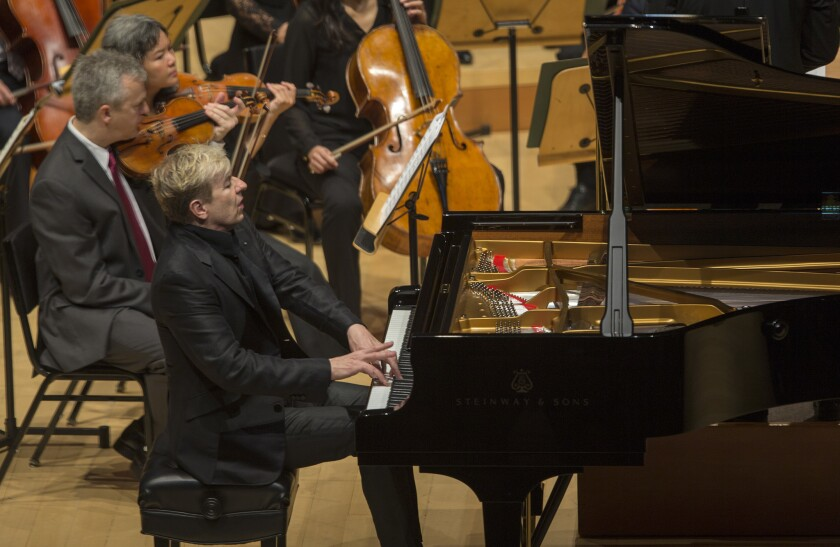 Pianist Jean-Yves Thibaudet performs with the Los Angeles Philharmonic at Walt Disney Concert Hall on April 29, 2016.