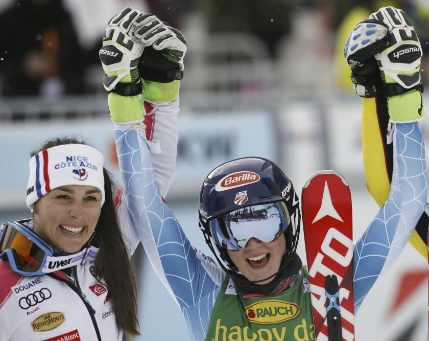 Mikaela Shiffrin, of the United States, right, celebrates with second placed France's Nastasia Noens after winning an alpine ski, women's World Cup slalom, in Crans Montana, Switzerland, Monday, Feb. 15, 2016. (AP Photo/Alessandro Trovati)