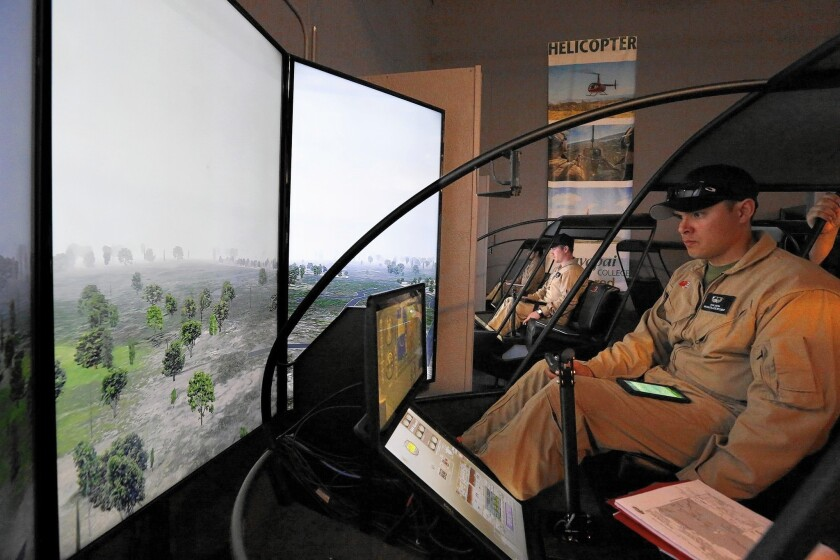 Marine Corps veteran Ryan Smith trains in a helicopter flight simulator at Yavapai College in Prescott, Ariz., under a government-funded program. The Department of Veterans Affairs has barred new enrollees in that program.