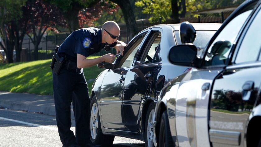 A police officer makes a traffic stop in Sacramento.