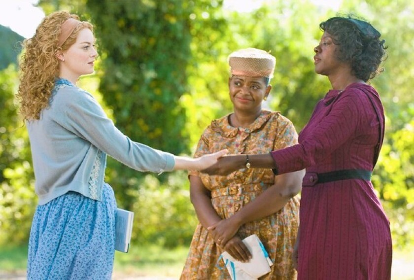 "REFLECTION: Emma Stone, left, Octavia Spencer and Viola Davis star in ""The Help,"" which has prompted residents of Jackson, Miss., to reexamine relations."