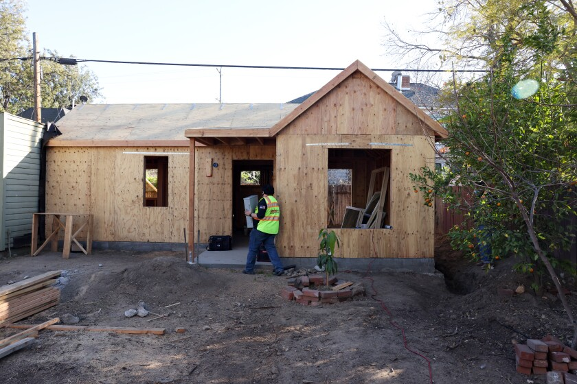 Andrew Aguayo works on an accessory dwelling unit
