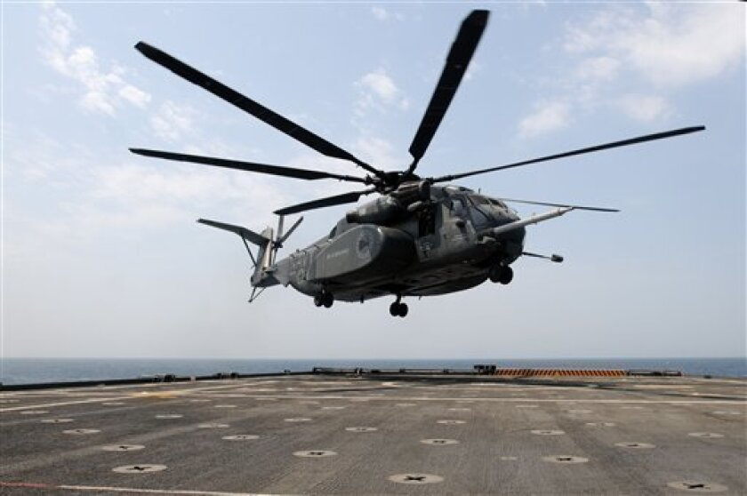 An MH-53E Sea Dragon helicopter preparing to land on the flight deck aboard the Afloat Forward Staging Base (Interim) USS Ponce in July 2012. (AP File Photo/U.S. Navy, MC2 Blake Midnight)