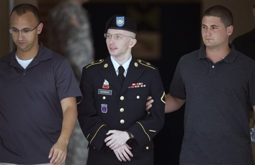 Army Pfc. Bradley Manning is escorted out of a courthouse at Fort Mead, Md, Thursday, July 25, 2013.