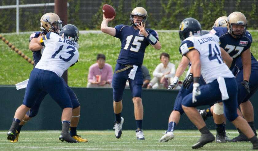 Former UCLA quarterback Jerry Neuheisel (15) plays for the Obic Seagulls in Japan's X League, the country's top-tier American football league.
