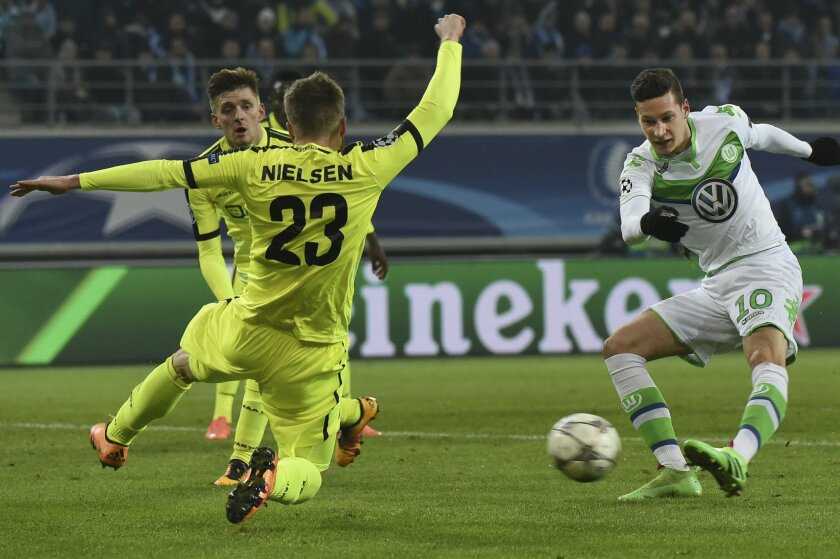 Wolfsburg's Julian Draxler, right, shoots on goal as Gent's Lasse Nielsen tries to block the shot during the Champions League round of 16, 1st leg soccer match between Gent and Wolfsburg at Ghelamco Arena in Ghent, Belgium, Wednesday, Feb. 17, 2016. (AP Photo/Geert Vanden Wijngaert)