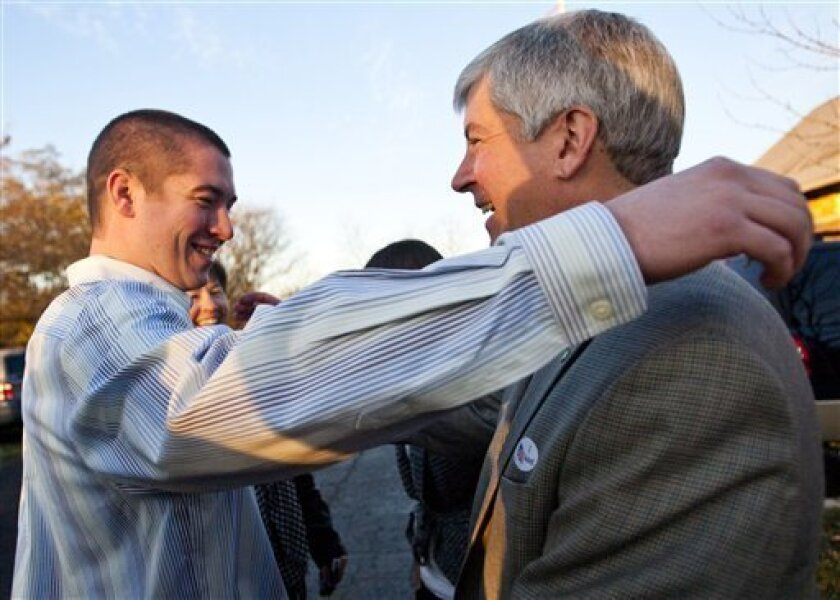 Michigan Republican gubernatorial candidate Rick Snyder, right, receives a hug from his son Jeff, after voting Tuesday, Nov. 2, 2010, in Superior Township, Mich. (AP Photo/Tony Ding)