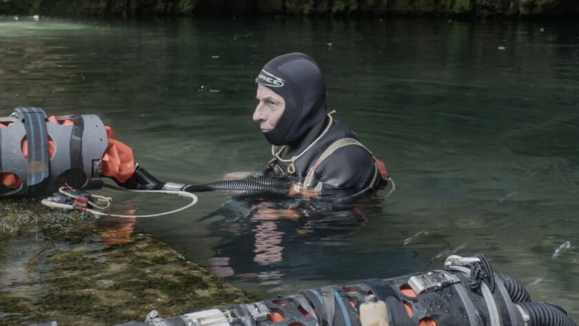 """A diver in shoulder-deep water in the documentary """"The Rescue."""""""