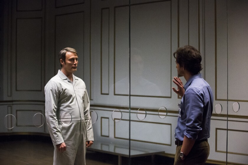 Mads Mikkelsen, left, as Hannibal Lecter, and Hugh Dancy as Will Graham.