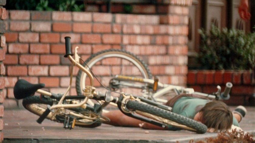 This photo of Omar Hernandez lying next to his bicycle on July 18, 1984, became a symbol of the devastating San Ysidro McDonald's massacre. The 11-year-old boy was among 21 people killed by James Oliver Huberty.
