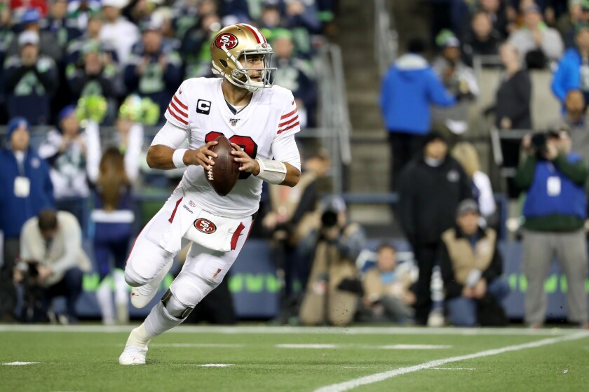 San Francisco 49ers quarterback Jimmy Garoppolo looks to pass against the Seattle Seahawks on Sunday.
