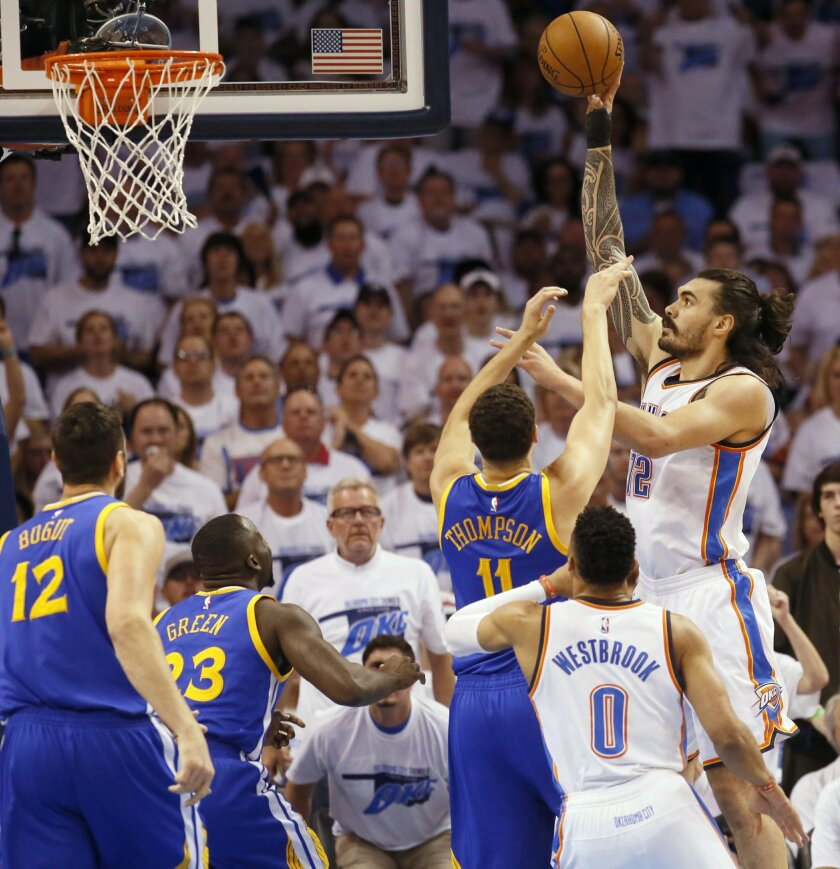 Oklahoma City Thunder center Steven Adams (12) shoots over Golden State Warriors guard Klay Thompson (11) during the first quarter in Game 3 of the NBA basketball Western Conference finals  in Oklahoma City, Sunday, May 22, 2016. (AP Photo/Sue Ogrocki)
