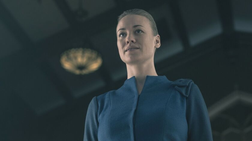 """This image released by Hulu shows Yvonne Strahovski in a scene from """"The Handmaid's Tale."""" On Thursd"""