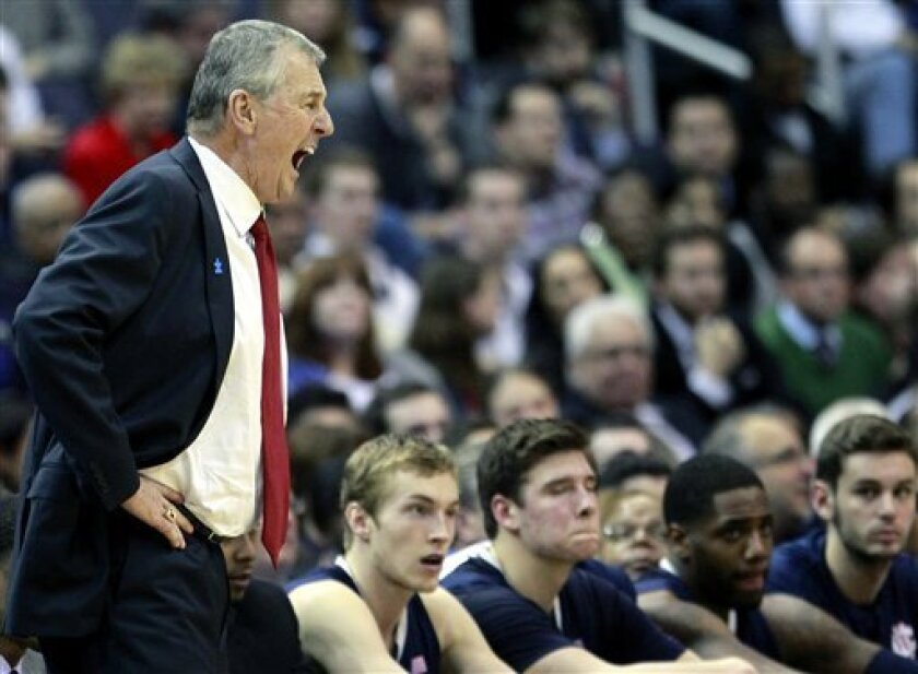 FILE - In this Feb. 1, 2012 file photo, Connecticut head coach Jim Calhoun yells to his team during the second half of an NCAA college basketball game against Georgetown, in Washington. The University of Connecticut has proposed reducing the number of games it will play next season if the NCAA grants a waiver to allow the Huskies to play in the 2013 men's basketball tournament. The school currently would be barred from the NCAA tournament, a penalty for years of below-standard academic results, but it requested a waiver last month. (AP Photo/Haraz Ghanbari, File)